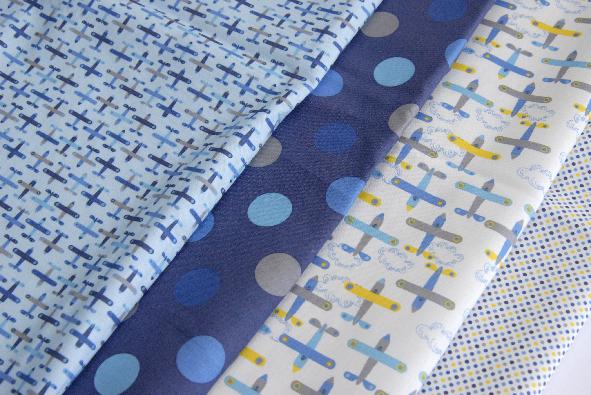 tissu motif petit avion bleu 1