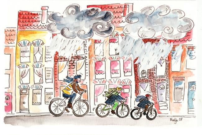 famille à vélo sous la pluie