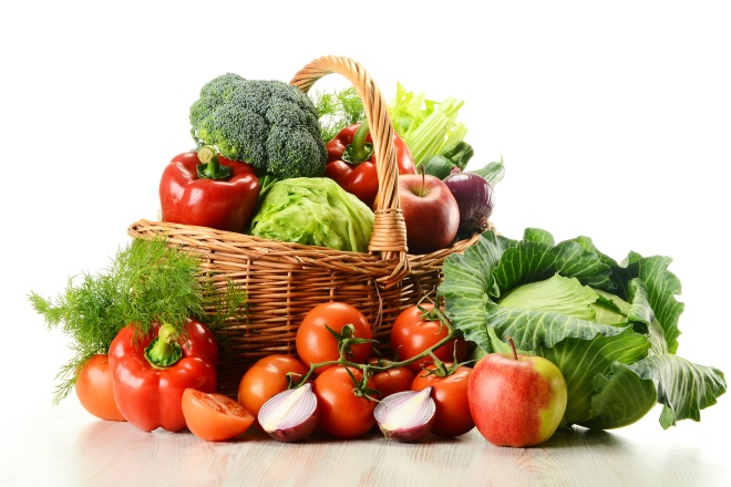 Vegetables in wicker basket isolated on white